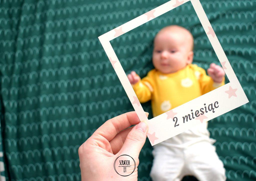 Dziecko oraz ramka 2 miesiące
